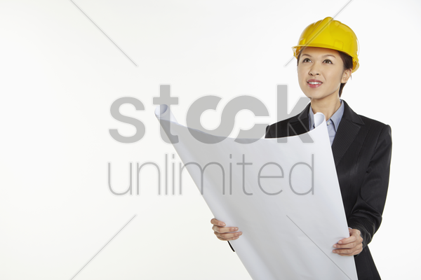 woman holding a construction plan stock photo