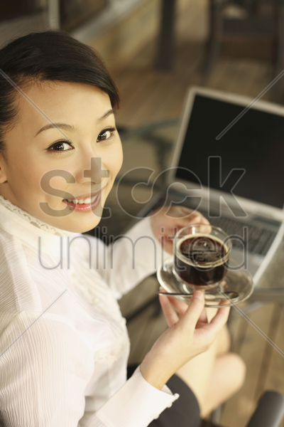 woman holding a cup of coffee, smiling stock photo