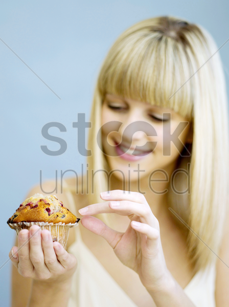 woman holding a cupcake stock photo