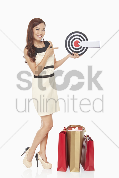 woman holding a dart board stock photo