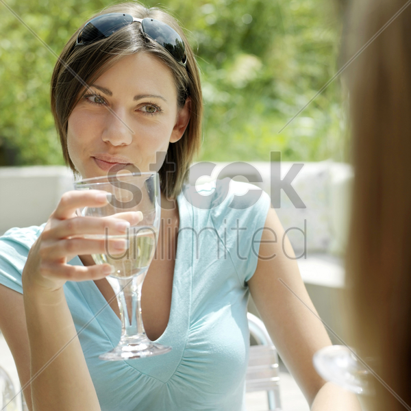 woman holding a glass of champagne stock photo