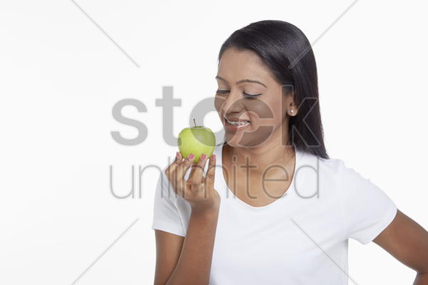 woman holding a green apple stock photo