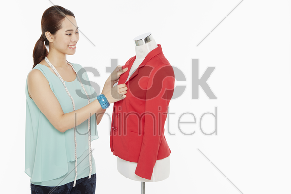 woman holding a jacket collar stock photo