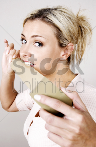 woman holding a length of tape stock photo