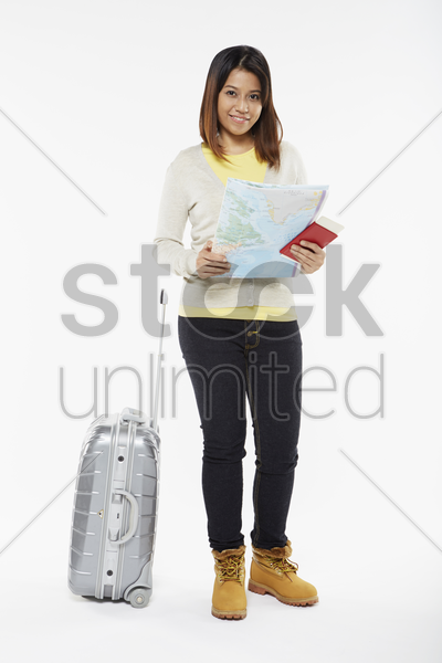 woman holding a map stock photo