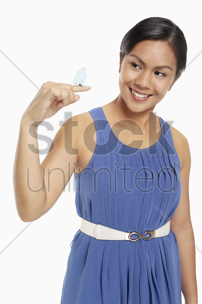 woman holding a miniature paper bird stock photo