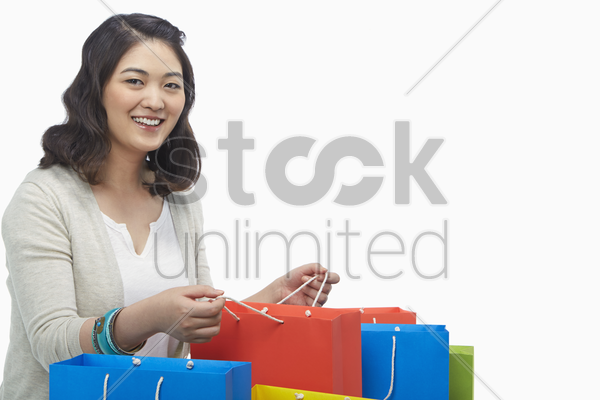 woman holding a paper bag, smiling stock photo