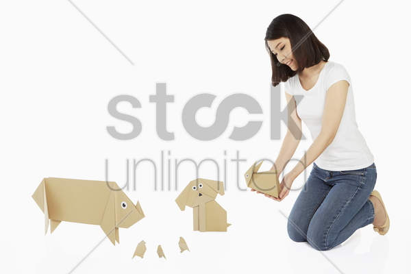 woman holding a paper rabbit stock photo