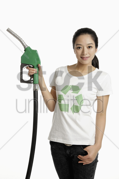 woman holding a petrol pump stock photo