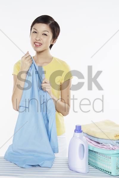 woman holding a piece of clean laundry stock photo