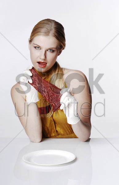 woman holding a piece of meat stock photo