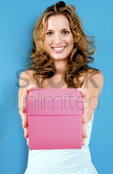 woman holding a pink box stock photo