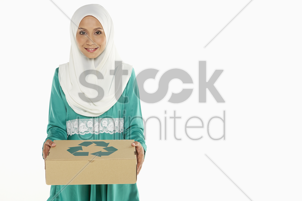 woman holding a recyclable cardboard box stock photo