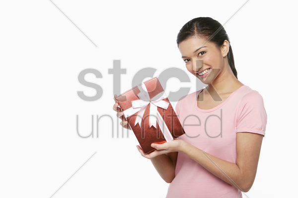 woman holding a red gift box stock photo