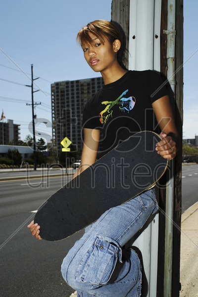 woman holding a skateboard stock photo