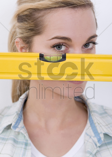 woman holding a spirit level stock photo