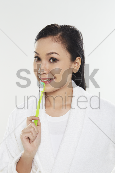 woman holding a tooth brush stock photo