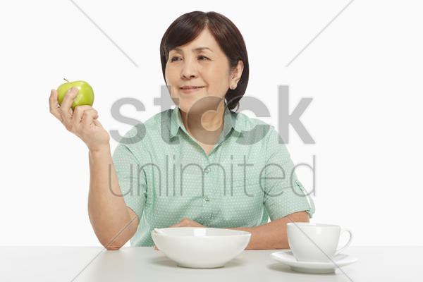 woman holding an apple stock photo