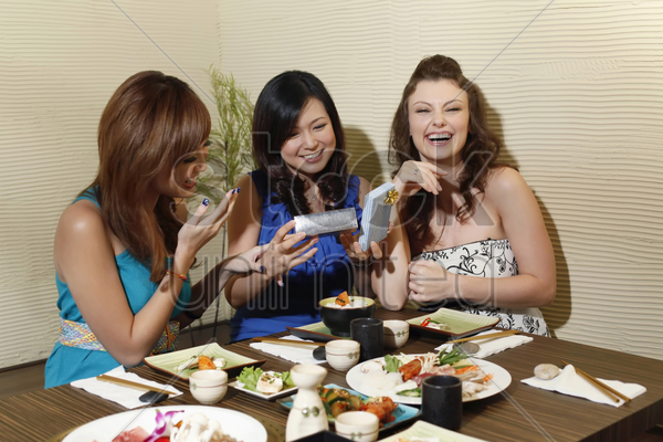woman holding an opened gift, friends laughing stock photo