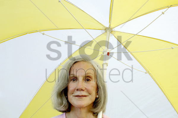 woman holding an umbrella stock photo