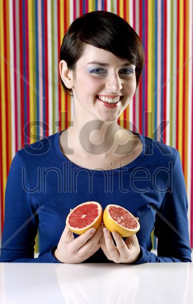 woman holding blood oranges stock photo