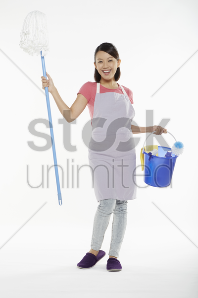 woman holding cleaning equipment stock photo