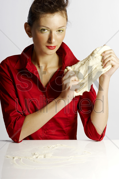 woman holding dough stock photo