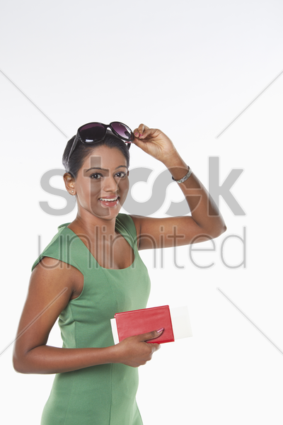 woman holding her passport stock photo