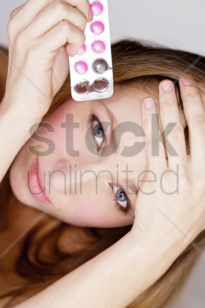 woman holding menstrual pill stock photo