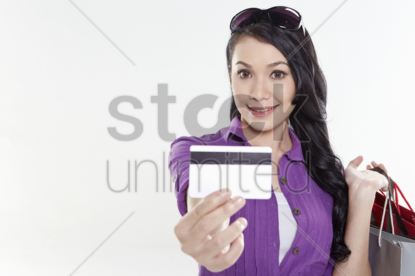 woman holding out credit card stock photo