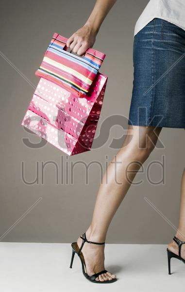woman holding paper bags stock photo