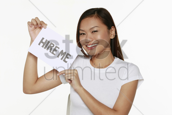 woman holding placard with text 'hire me' stock photo