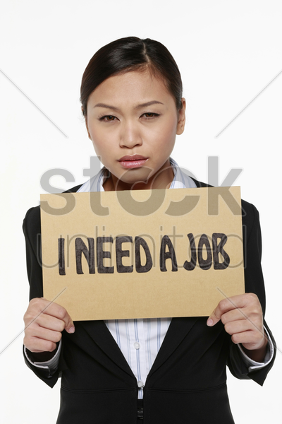 woman holding placard with text 'i need a job' stock photo