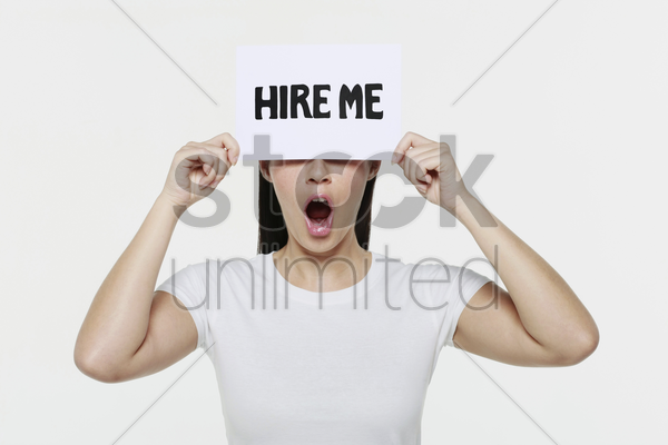 woman holding placard with text on it stock photo