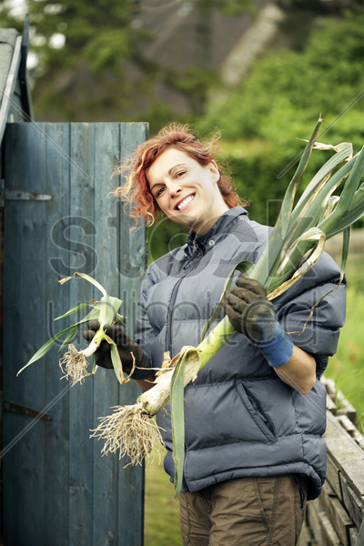 woman holding plants stock photo