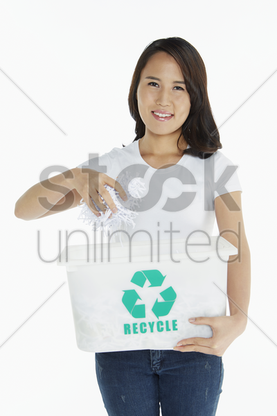 woman holding shredded papers stock photo