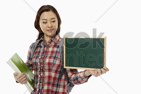 woman holding up a blackboard stock photo