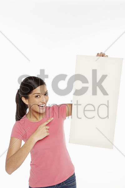 woman holding up a blank placard stock photo