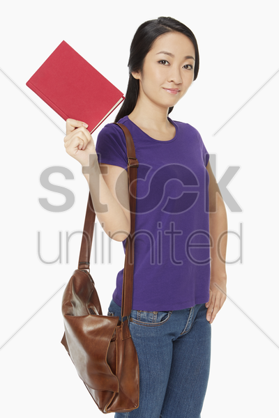 woman holding up a book stock photo