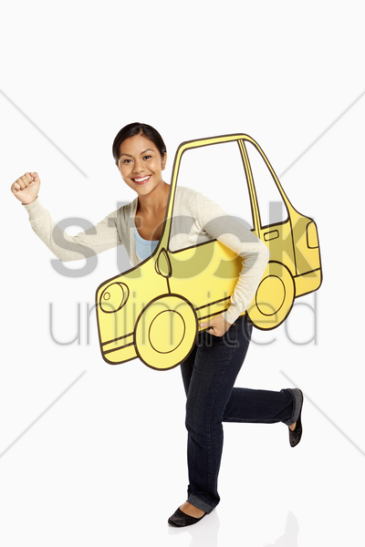 woman holding up a cardboard car, cheering stock photo