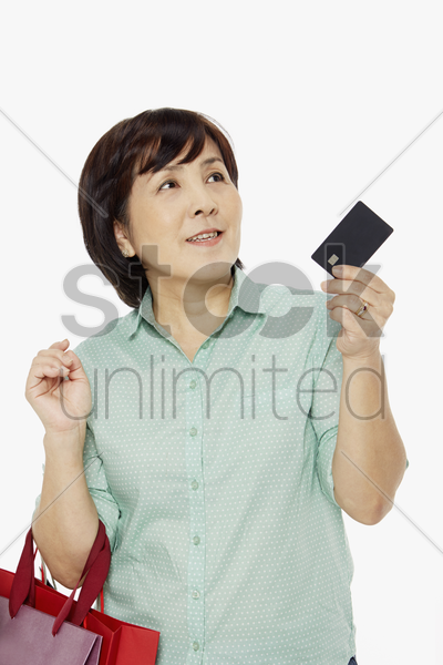 woman holding up a credit card stock photo
