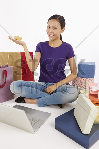 woman holding up a gift box stock photo