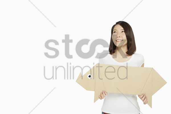 woman holding up a paper pig stock photo