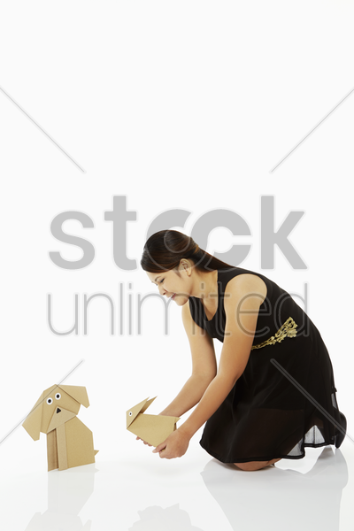 woman holding up a paper rabbit stock photo