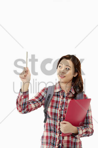 woman holding up a pen stock photo
