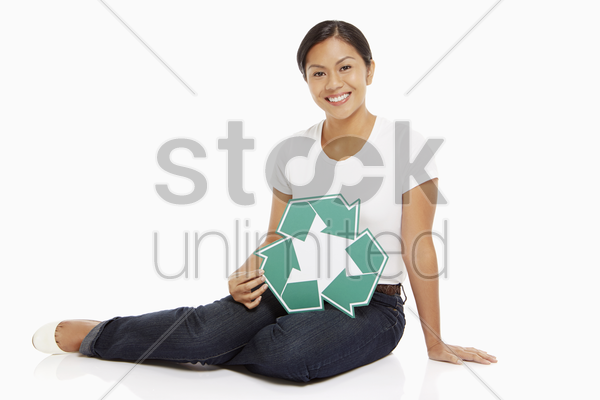 woman holding up a recycle logo stock photo