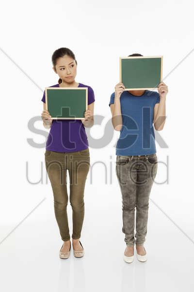 woman holding up a small blackboard stock photo