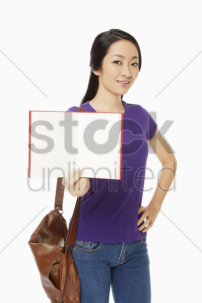woman holding up an opened book stock photo