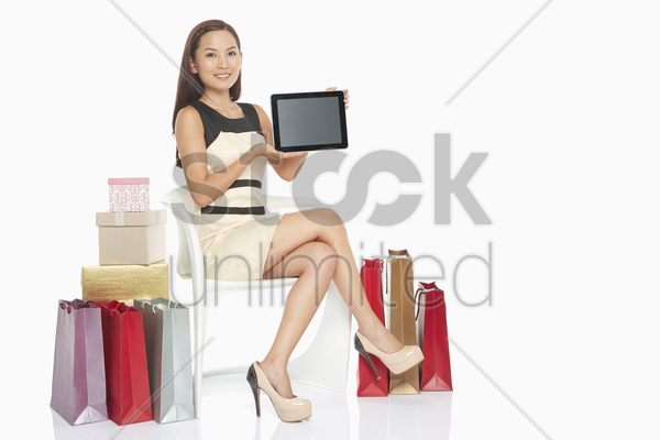 woman holding up digital tablet stock photo