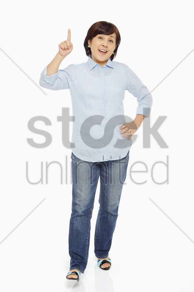 woman holding up her index finger stock photo